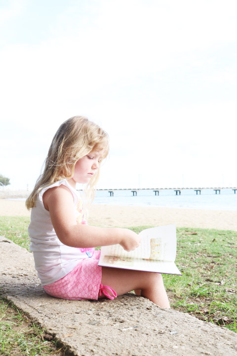 girl reading may gibbs book by the sea