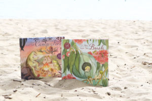 May Gibbs books nestled in sand on a summers day