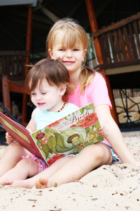 two children reading may gibbs book