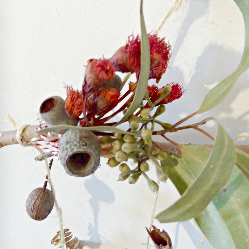 nature based play wall hanging gum nuts leaves flowers