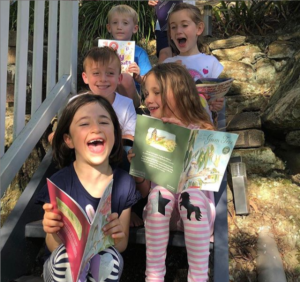 Kids reading May Gibbs books